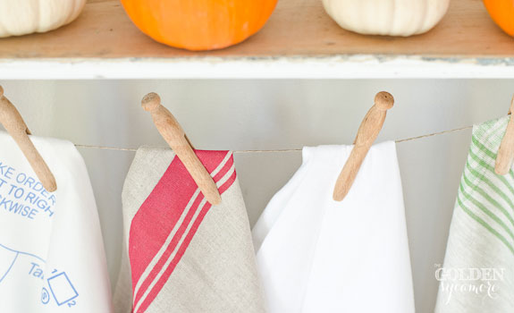 Tea towels, vintage clothes pins, and pumpkins
