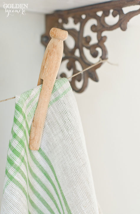 Green striped tea towel and vintage clothes pin display