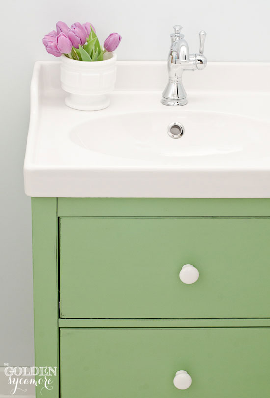Custom green vanity with white knobs