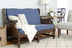 Blue Ikat Dots Sunshine fabric on vintage upholstered sofa