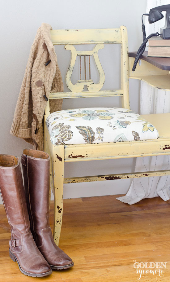 Chippy painted telephone table with distressed muted floral fabric