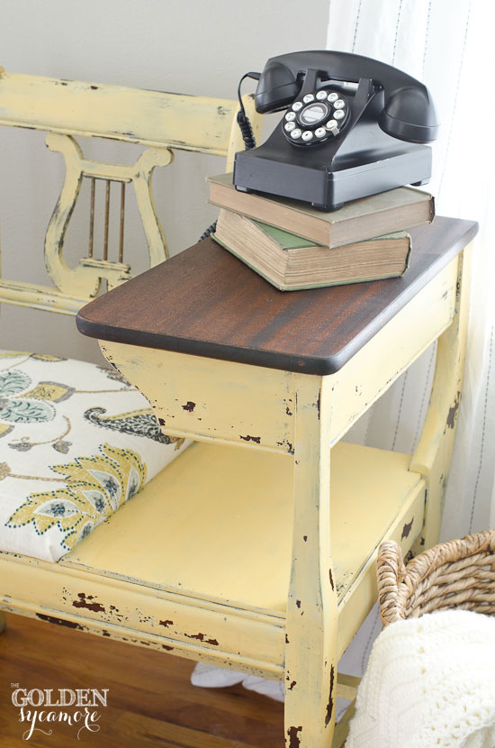 Chippy yellow telephone table with wood stained desk top
