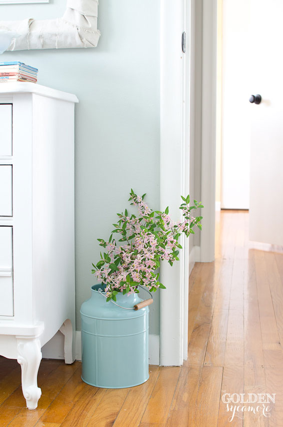 Aqua planter with pink flowers in cottage style little girl's room makeover