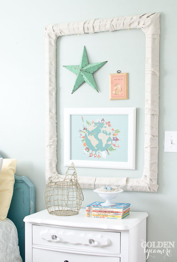 Mini gallery wall and white nightstand in little girl's bedroom makeover
