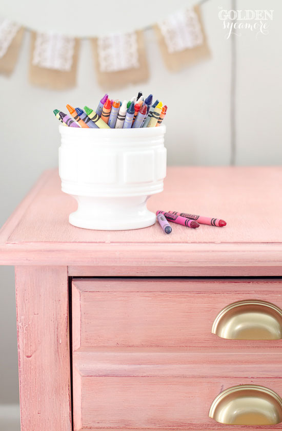 Girly pink nightstand with gold drawer pulls