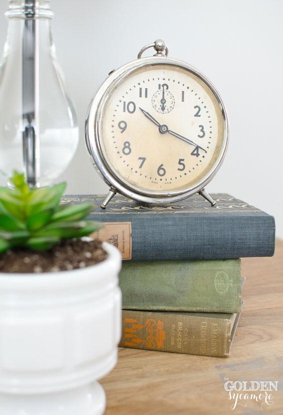 Vintage clock on vintage books