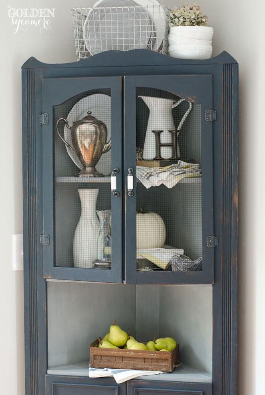 Artissimo milk painted corner cabinet