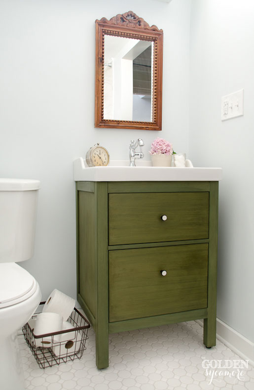 Ikea bathroom vanity turned antique looking one-of-a-kind piece with milk