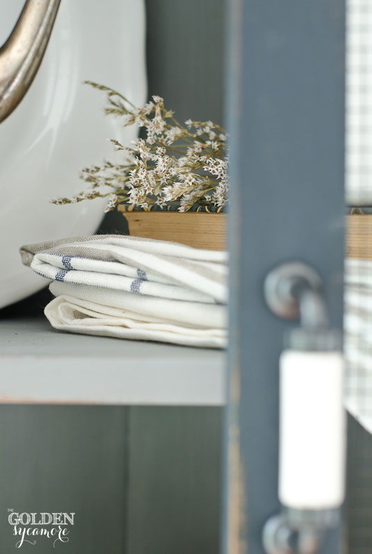 Linens in trash to treasure corner cabinet