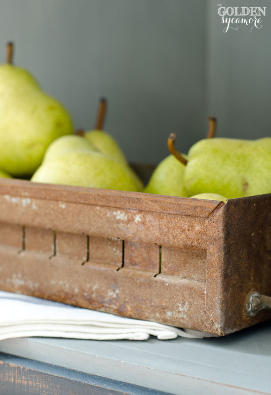 Pears in rusted container
