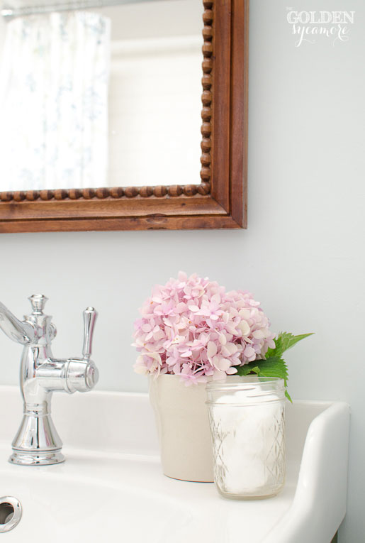 Pink hydrangea in cottage bathroom