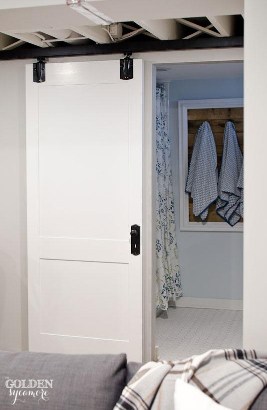 DIY white paneled sliding bathroom door