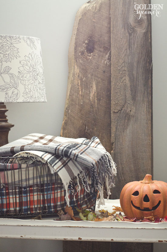 Fall decorating with plaid blankets & barn wood
