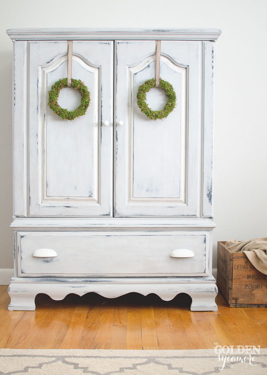 Milk painted armoire perfect for a neutral nursery | via www.thegoldensycamore.com