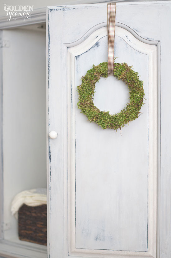 Moss wreath and blue and white milk painted armoire makeover | via www.thegoldensycamore.com