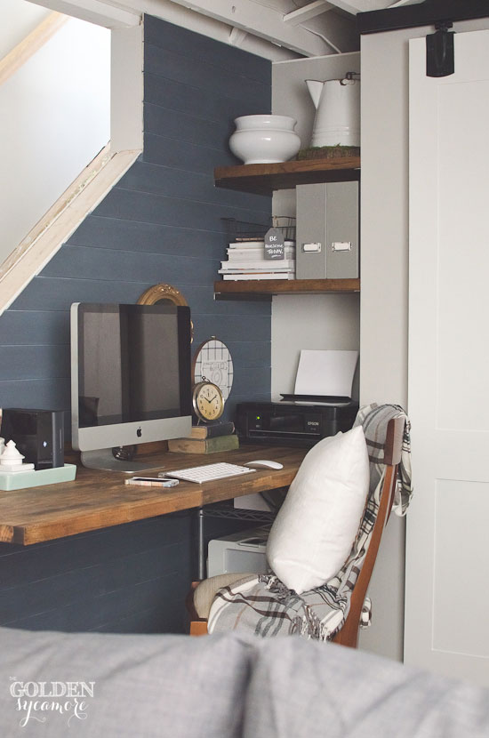 Rustic basement small office nook