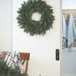 Rustic Christmas decor with gorgeous wreath on sliding barn style door