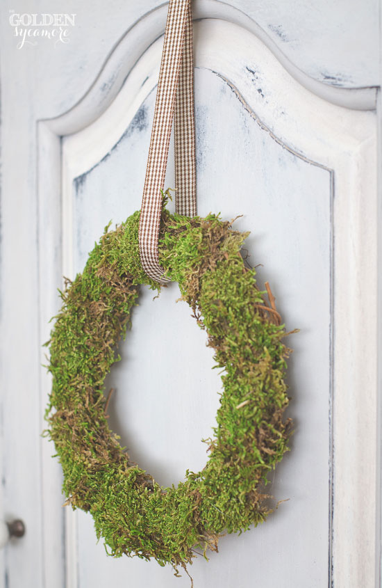 Small moss wreath on shutter gray milk painted armoire | via www.thegoldensycamore.com