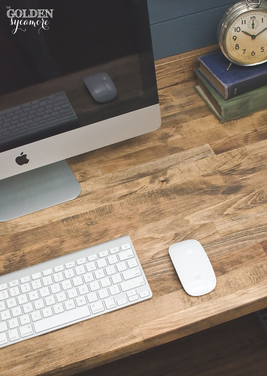 stained ikea butcher block desk in small office