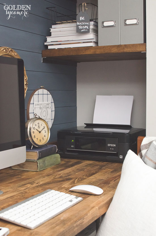 Using the most of a small space with butcher block desk and shelves built in to small nook by stairway