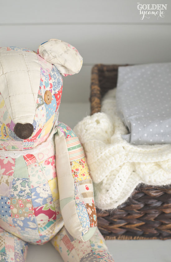 Vintage patchwork bear in painted armoire | via www.thegoldensycamore.com