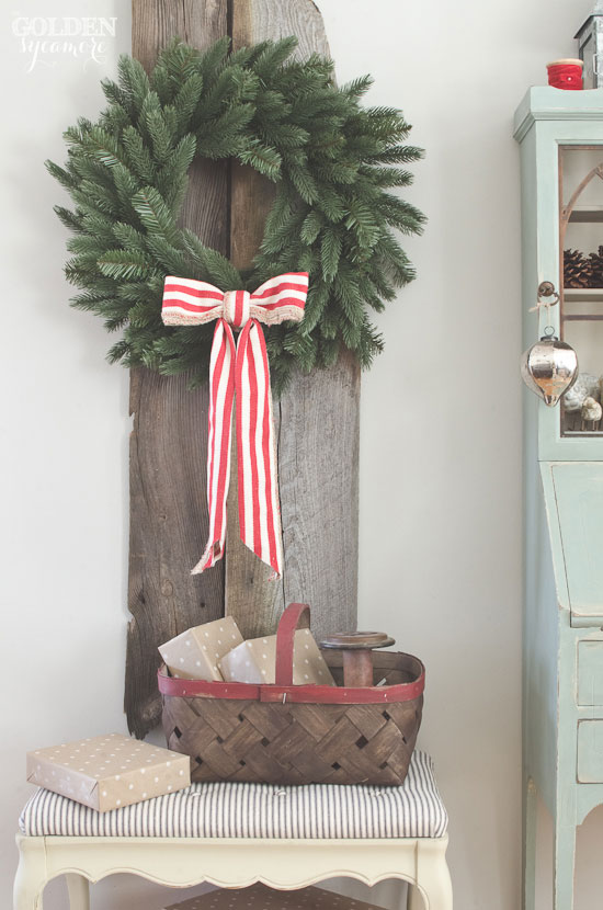 Beautiful big wreath on rustic barn wood via www.thegoldensycamore.com