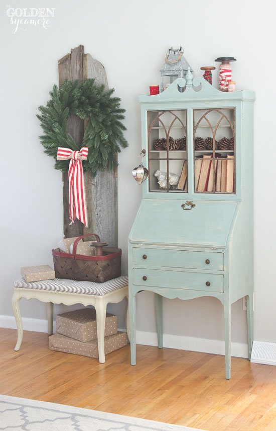 Cozy, rustic Christmas decor with striped bench makeover