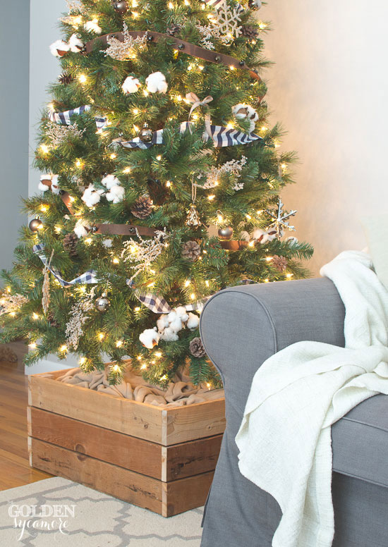 Easy DIY Christmas tree stand box is a great alternative to a tree skirt
