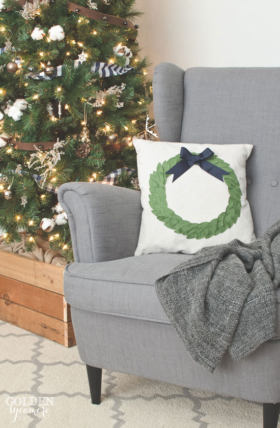 Faux boxwood wreath pillow and rustic Christmas tree via www.thegoldensycamore.com