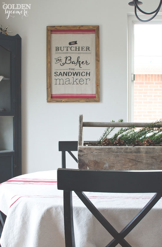 Rustic Christmas dining room with tea towel wall art via www.thegoldensycamore.com