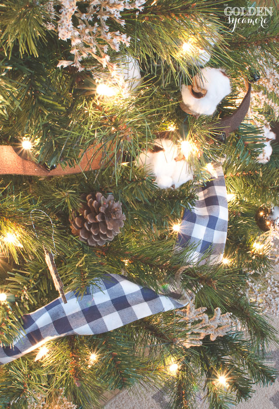 Rustic Christmas tree with cotton bolls, DIY blue checked fabric ribbon, and pine cones