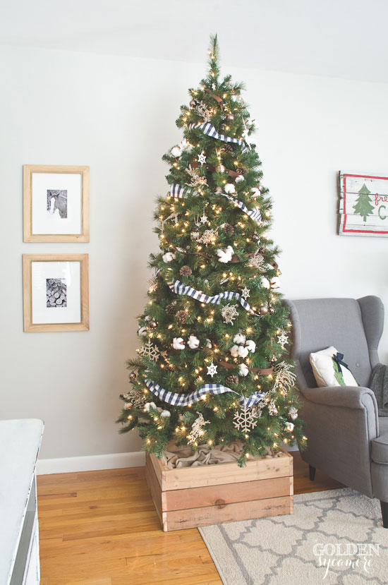 Rustic Christmas tree with handmade DIY tree stand box via www.thegoldensycamore.com