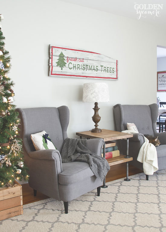 Rustic living room with barn wood fresh cut Christmas trees sign - thegoldensycamore.com