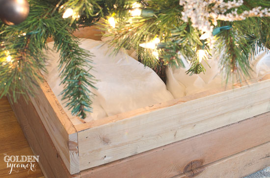 Stuff pillows in Christmas tree stand box to fill it up