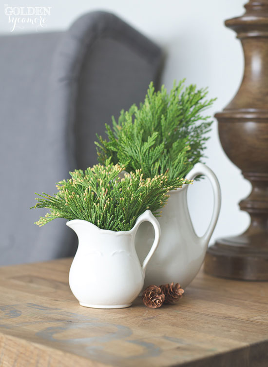Cedar greenery in vintage white pitchers - thegoldensycamore.com