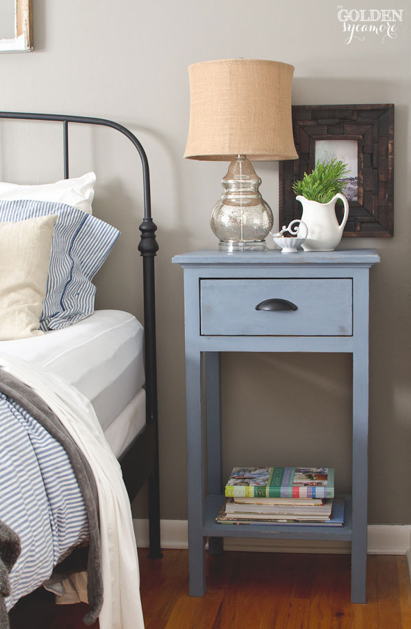Cute Black iron Ikea bed frame and DIY blue nightstand in rustic cottage bedroom thegoldensycamore