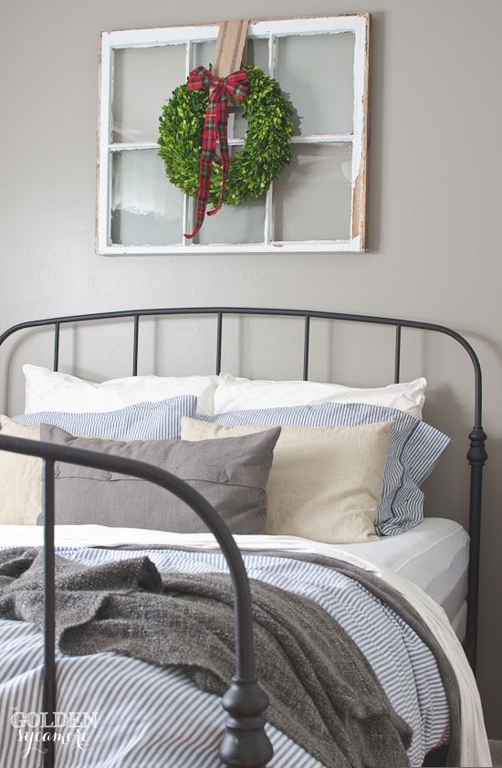Vintage Black iron Ikea bed frame in rustic cottage bedroom thegoldensycamore