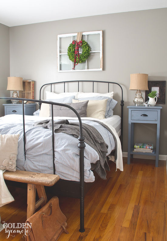 Black iron Ikea bed frame in rustic cottage bedroom - thegoldensycamore.com