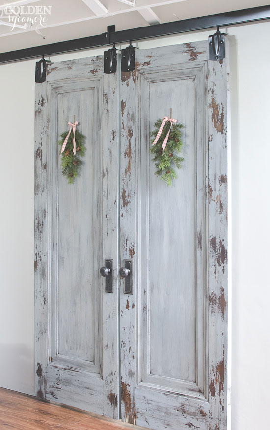 Pine swags on old chippy sliding doors via www.thegoldensycamore.com