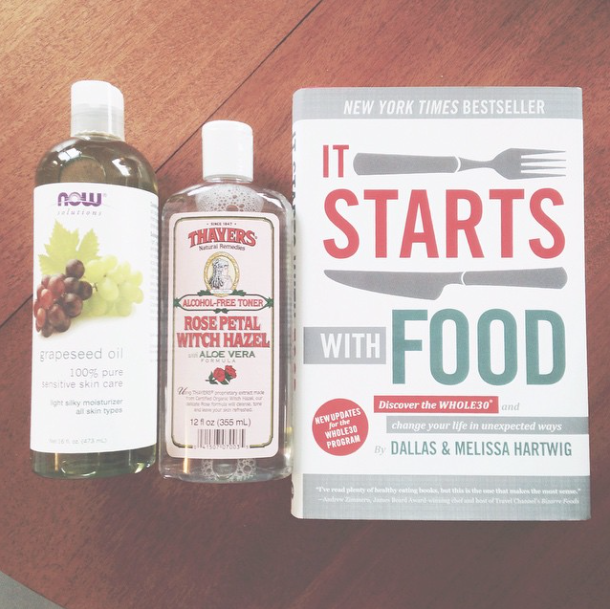 "Grapeseed oil, witch hazel, and ""It Starts with Food"" Whole30 book"
