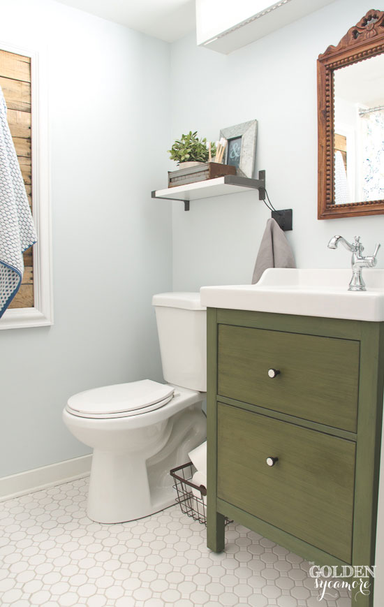 Beautiful guest bathroom with whites, greens, and blues - thegoldensycamore.com