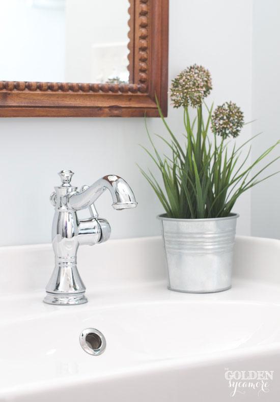 Crisp, clean bathroom remodel - thegoldensycamore.com