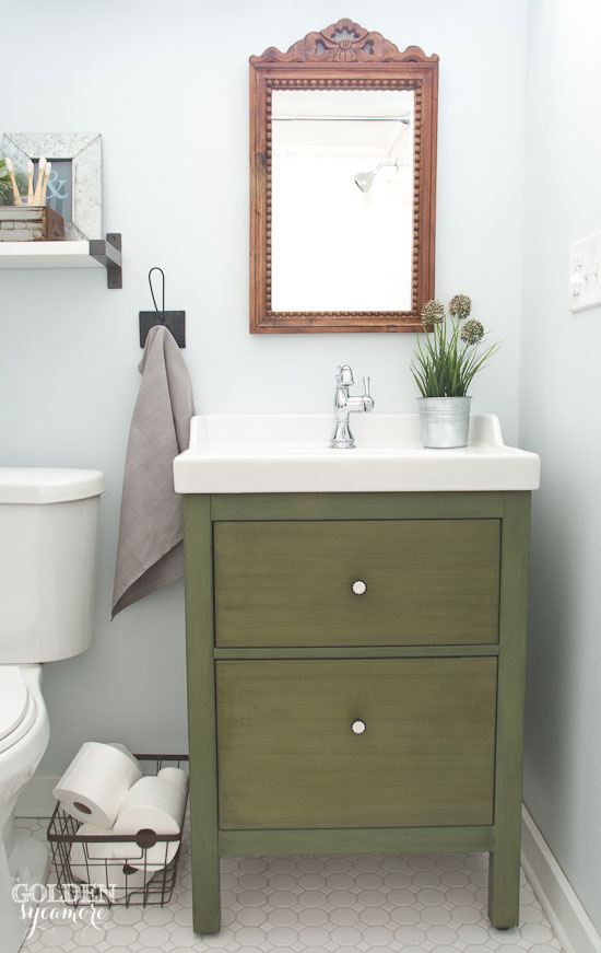 Dark green bathroom vanity with vintage mirror above - thegoldensycamore.com