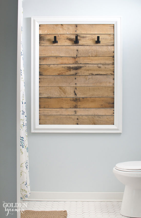 Clever way to hang bathroom towels - framed old pallet boards - thegoldensycamore.com