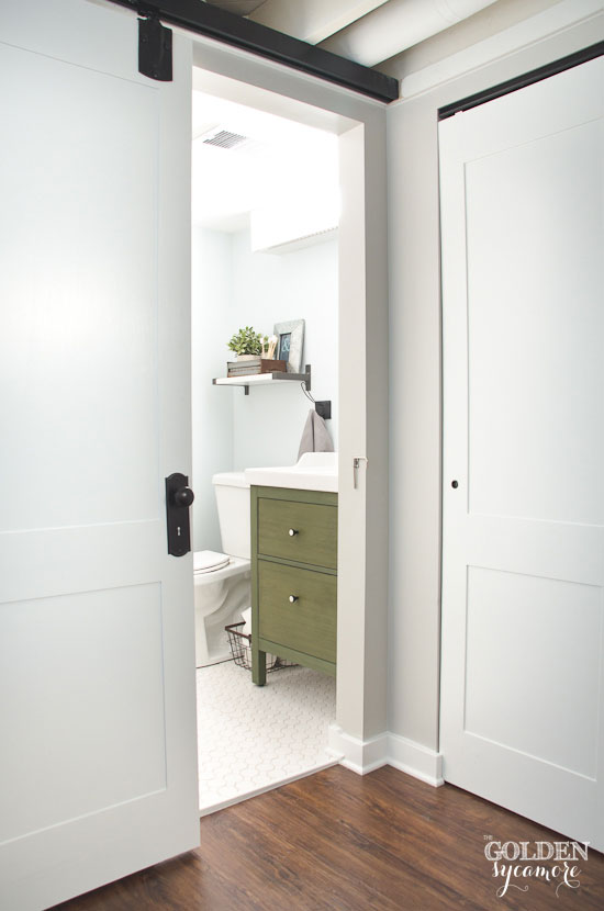 Sliding door on basement bathroom - thegoldensycamore.com