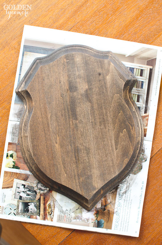 Finished shield plaque stained with milk paint and sealed with hemp oil wet sanding via thegoldensycamore.com