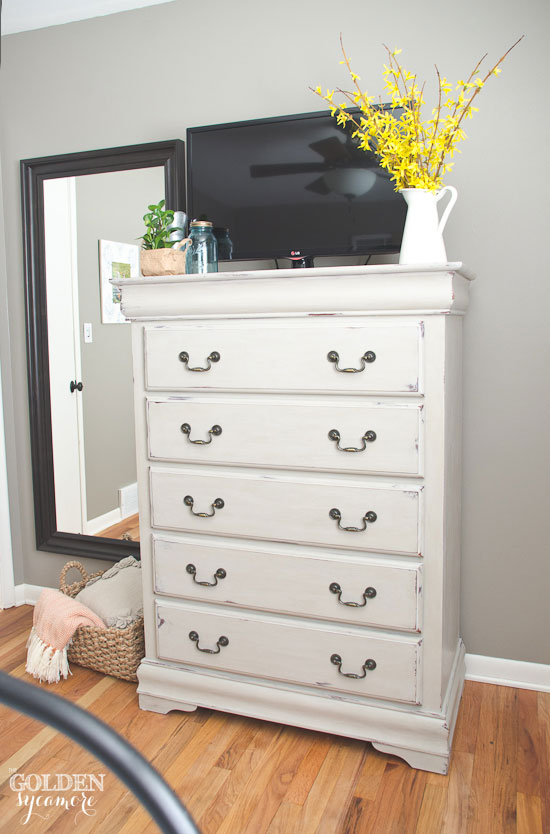 Light beige painted bedroom dresser