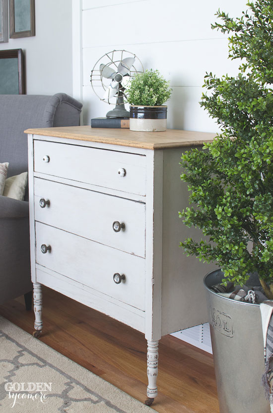 Gray dresser with natural wood top
