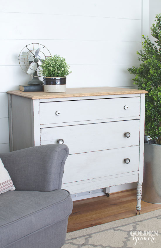 Gray painted dresser against beautiful white plank wall