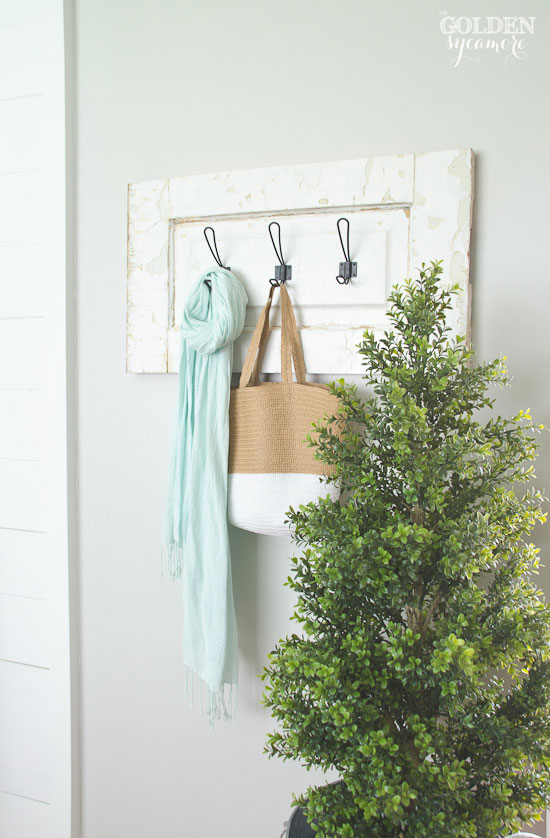 Unique coat rack made out of a repurposed old door!